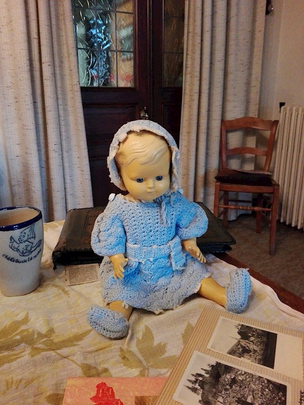 Even at old age, Andrée cherished the doll she rescued from her ruined town. © Andrée Collin