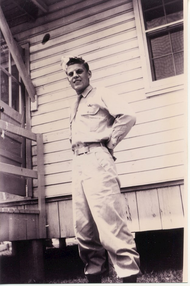 Fred posing in front of a military barrack in the United States. © Glavan family